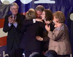 Hillary Rodham Clinton turns to hug her husband, President Clinton, daughter…