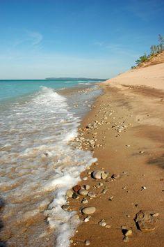 Crystal blue waters of Lake Michigan and miles of beaches along Sleeping Bear Dunes near Traverse City, Michigan.