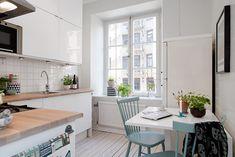 Sweet swedish kitchen with robin-egg blue chairs - Alvhem Mäkleri och Interiör | För oss är det en livsstil att hitta hem.