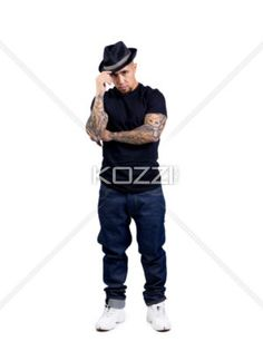 portrait of a young macho man posing on white background - Portrait of a stylish young man with tattooed arms on white background