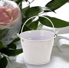 Perfect for a beach or garden party themed wedding reception or bridal shower, these adorable miniature white favor pails will delight your guests as they discover them filled with creative sweets and treats.