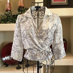 Host PickThe Limited silk wrap around top The Limited silk wrap around top, 3/4 sleeves, perfect to wear with high waisted jeans. 100% silk The Limited Tops Blouses