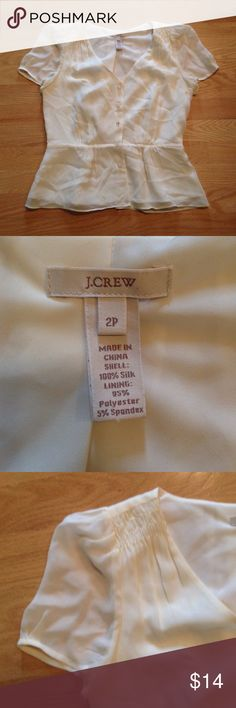 Vintage Unique J. Crew Blouse Button Up Peplum This top is very delicate and in a cream color. It has gathering on the sleeve caps and at the waist. The buttons are gorgeous beads. The lining is 100% silk and the out side is polyester and spandex. The only damage is on the right side with a tiny brown stain that is unnoticeable when worn. Otherwise it is in great condition! J. Crew Tops Blouses
