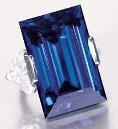 The Rockefeller Sapphire is a 62.02-carat, rectangular step-cut, internally flawless, cornflower blue sapphire of Burmese origin, with a rich highly saturated intense blue color, so characteristic of Burmese sapphires. The fine brilliant deep-blue color combined with the good clarity and transparency of the stone had made this unique sapphire the most expensive sapphire in the world.
