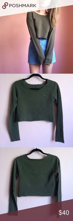 Insight Olive Long Sleeve Crop Sweater Olive you in this sweet little crop by Aussie brand, Insight. Features a scoop neck, long sleeves and cropped hem in an olive color with small stitched insignia. Wear with high waisted denim and white sneakers. Fits a bit small like a US 2 or XS/S. Marked size AU 8 / US 4. No returns allowed. Please ask all questions before buying. IG: [at] jacqueline.pak #insight Tops Crop Tops