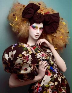 Editorial fashion..pose I wouldn't want to comb that ratted mess out