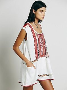 Sleeveless Embroidered Tunic   Embellished shapeless tunic with a drop-waist silhouette and pockets. Features elaborate beading, embroidery, and sheer lattice inserts. Back cutout.