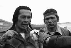 Russell Means, left, and Dennis Banks, speak to reporters during the 1973 American Indian Movement standoff at the Pine Ridge Reservation in South Dakota.
