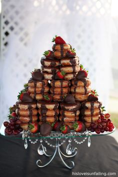 Chocolate covered strawberries and donut wedding cake.  ERRYBODY KNOW I LOVE ME SOME DONUTS