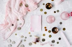 #Paper blank and coins  Pink empty paper blank with coins candlesticks and pink textile on concrete background. Flat lay composition for bloggers magazines social media designers and artists. This purchase includes one high resolution horizontal digital image. Image is a sRBG jpg and is approximately 5324x3549 pixels. License terms: http://ift.tt/1W9AIer
