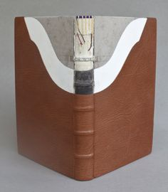 Double flexible binding by Kate Barber; English; Modern. Goat leather; marbled paper endsheets; double flexible binding; three color silk endband. Dimensions: 22.2 x 14.6 x 2.8 cm.