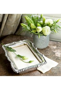 """""""Not Just For Napkins"""" boxes  are so versatile... Use them for serving dips, candies, nuts, or for holding your jewelry, hair clips, or perfume bottles ... or for guest towels!  Made of an FDA safe, easy-care, oven and freezer friendly aluminum alloy. 10 1/2 x 7 1/4 x 2   Of heirloom quality, BEATRIZ BALL handmade aluminum metalware will not tarnish or lose its shine. It can be used with confidence to heat, chill and safely serve food. Acidic foods will not damage or discolor product.  To…"""