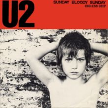 """Album cover for U2's single """"Sunday Bloody Sunday,"""" title track on the 1983 album WAR and one of U2's most overtly political songs."""