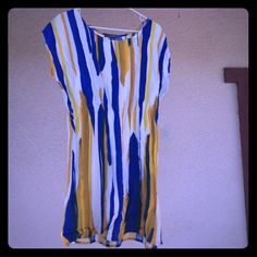 Forever 21 Shirt Length Dress Cream & Mustard This is a never worn tags still attached, off the shoulder Shirt length dress. You can wear it as a top with cute leggings or be super flirty as a dress with sandals or heels. Whatever your style. It's Cobalt Blue, Cream and Mustard. Size Large. Forever 21 Dresses