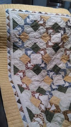 Marcia's quilt. Piano key border, dragonfly E2E in center.