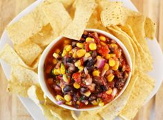 south west salsa. a delicious combo of corn, black beans, tomatoes, onion and more that will remind us of summer days