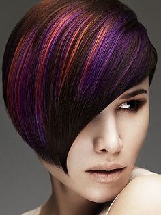 Purple, copper, and burgandy hair. Short one side cut, a-line.