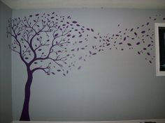 my purple tree on a grey wall, this is the master bedroom. all free handed and just the rite touch to a room