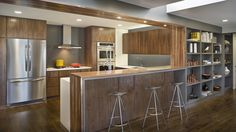 Cool Kitchen Design in Clean and Futuristic Interior Layout : Awesome Contemporary Kitchen With Long Island For Cozy Bar Completed With A Se. Walnut Cabinets, Wood Cabinets, Kitchen With Long Island, Cozy Bar, 1960s House, Futuristic Interior, Layout, Cool Kitchens, Architecture Design
