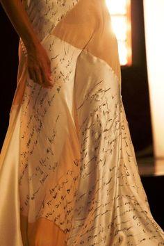 Project Runway: Jeremy's white dress. Love letter written on it.