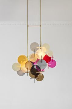 SETTANTA creme smoke red pink - designed by vibeke fonnesberg schmidt Settanta is a brand new chandelier made in plexiglass and brass. It is constructed of 70 circular pieces and has 2 light sources.