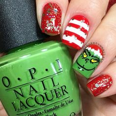 The Grinch  Hello lovely friends. This are my nails for today and tomorrow  Sadly I can't post a video cause I ruined it and I have not time to make a new one  But I wish you a very Merry Christmas to all of you and your families. Have fun, eat well and take care everyone. Love you all  I used  @opi_products Big apple red Alpine Snow Green-wich Village  @chinaglazeofficial Bring on the bubbly  Details Hand painted with acrylic paint and a brush from @ebay  @glistenandglow1  Hk Girl top✨ coat