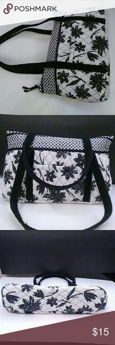 Used Vera Bradley bag Used White and black Vera Bradley bag 9 inches long by16 wide by 4 inches deep. Handles are 11 inches long . Bag is used but there are no tears or stains or anything That I could see. Wrong inside is clean and still has cardboard for the bottom. There are two slip pokets inside for small items  and a. Slip pocket outside.bag from pet smoke free home. The colors are black flowers white background .  Circle  pattern on top Vera Bradley Bags Shoulder Bags