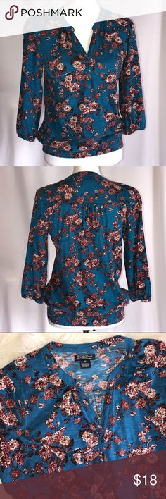 "Lucky Brand Teal Floral Cotton Stretch Peasant Top Stretchy peasant top from Lucky Brand  3/4 sleeves with button cuff.  Elastic waist.  3 button neckline.  Deep teal color with Floral print.  100% cotton.  Size Medium. Approx: pit to pit laying flat 19.25"", length 23.25"".  In good condition. Lucky Brand Tops"