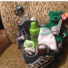 Personalize Philadelphia eagle diaper cake Will make upon interest or order Onesie will personalize name on or say eagles  Philadelphia eagle blanket 2 bibs  Pacifier Football  Eagle helmet Eagle pointer  Ty stuff bear  Diapers  Will b wrap in plastic with ribbon Other