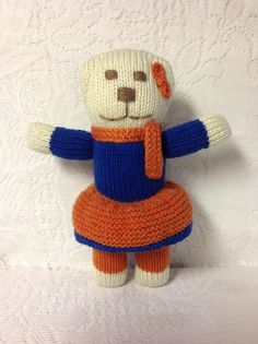 DENVER BRONCOS TEDDYBEAR!  Hand knitted girl teddybear is 11 inches tall with an 8 inch arm span and she costs $16.00 with an additional USA $4.54 first class shipping charge!  Priority mail costs $7:15