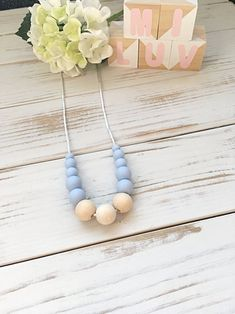 This blue nursing necklace will keep your little one entertained for hours- a great distraction for those restless, inquisitive and curious babies while feeding!  This environmentally friendly necklace is made from 100% food-grade silicone beads and natural untreated eco wood. The necklace is complete with a strong 60cm satin nylon cord and features a safety breakaway clasp, designed to pop open when pulled and tugged on. Tassel Necklace, Turquoise Necklace, Necklaces, Nursing Necklace, New Mums, Teething, Food Grade, Cord, Safety