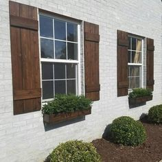 ~Listing is for ONE PAIR = 2 SHUTTERS ! ** Farmhouse Board and batten style Shutters ** ~ A perfect way to add curb appeal to your home! SHUTTER DETAILS:: ~ Custom made to order. ~ Made from rough sawn Red Cedar. ~Pictured shutters are wide and done i Café Exterior, House Paint Exterior, Exterior Remodel, Exterior House Colors, Exterior Design, Exterior Shutters, Rustic Exterior, Stained Brick Exterior, White Wash Brick Exterior