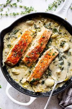 This one-skillet salmon with creamy spinach artichoke sauce is so comforting and packed with flavor and veggies! It's paleo, Whole30 compliant and keto friendly. Great for a delicious and healthy weeknight meal served alone or over cauliflower rice.#paleo #whole30 #keto #cleaneating Artichoke Sauce, Artichoke Recipes, Spinach Recipes, Spinach Meals, Healthy Weeknight Meals, Healthy Dinner Recipes, Whole30 Salmon Recipes, Paleo Running Momma, Salmon Seasoning