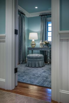 """Located off of the master gallery, the dressing room is situated between the master closet and bathroom. """"As you walk down the hall and peek in, the dressing room references the fantasy that we all have about spaces we'd like to have in our house,"""" explains Linda."""