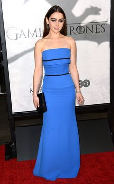 """Emilia Clarke steals the spotlight in a stunningly sleek Victoria Beckham strapless dress at the 2013 Season 3 Premiere of HBO's """"Game of Thrones""""."""