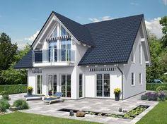 Beispielhaus 19.0 • Einfamilienhaus von Ytong Bausatzhaus • Prägnantes Massivhaus mit Zwerchdach und in drei Zonen gegliedertem Grundriss • Jetzt bei Musterhaus.net informieren!