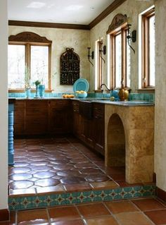 detail of saltillo tile floor and lower cabinets in turquoise tile mexican style kitchen - Jean Stoffer Design via Atticmag Mexican Tile Kitchen, Mexican Kitchens, Kitchen Tiles, Hacienda Kitchen, Spanish Colonial Kitchen, Mexican Tiles, Mexican Kitchen Styles, Kitchen Colors, Rustic Kitchen