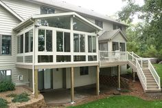 Patio rooms installed above walk out basements are popular for the added space they bring to split level homes. Outdoor stairs leading up to the deck and sunroom are a convenient way for the kids to enter the house after playing outdoors.
