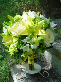 """Cheery, summery bouquet with yellow lilies, """"Mondial"""" roses, freesia, tied with a french twist ribbon."""