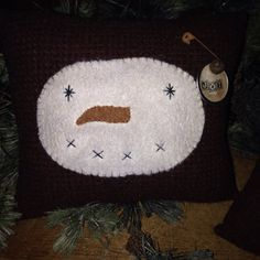 Listing is for the set. These pillows are made from red/black small checked wool with a cotton calico fabric for the back. The snowman is a white fleece thats hand stitched on. I hand stitched the eyes/mouth and gave him orange wool nose. To finish I added a grungy tags with rusty pins/bells. All fabric is aged in my prim recipe.     Youll receive both pillows as a set 😊 Pillows measure 7 x 6 and 8 x 5. Perfect to tuck in your primitive/country home for Christmas/Win...