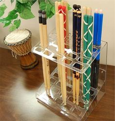 Drumstick Display Rack. This cool drumstick rack makes the perfect holder for those cool sticks of yours. It keeps them in order and easily accessible. Makes a great, practical gift for a drummer and it also makes a great decoration for the bedroom, practice room or drum studio. A DRUM BUM exclusive! #drums #drummer #drumbum - From store.drumbum.com