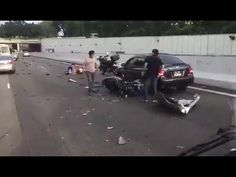 Aftermath – car crashes head on with motorcycle