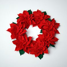 Make a Felt Poinsettia wreath from @DollarTree stocking and cardboard @savedbyloves