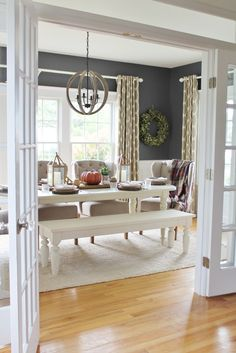 Love this dining room, white painted furniture, textured neutral curtains, bay leaf wreath.....