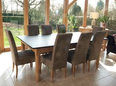 The Large Table You See Here Just looks Simply Stunning In This Limestone Floored Green Oak Conservatory, The Customer Was Very Pleased With how It Fitted Into The Design Of The House Large Table, A Table, Dining Table, Solid Oak Coffee Table, Limestone Flooring, Handmade Table, Kitchen Tops, Farmhouse Furniture, Fine Furniture
