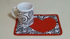 big red heart on black & white floral mug rug Colorful Quilts, Small Quilts, Mini Quilts, Valentines Mugs, Valentine Theme, Mug Rug Patterns, Fabric Postcards, Table Runner And Placemats, Penny Rugs