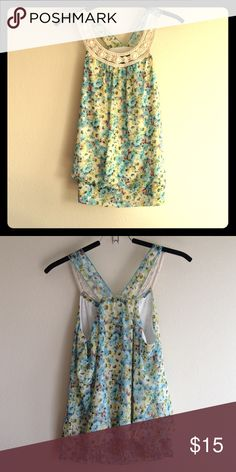 Cute Beaded Summer Top Soft floral lined top with beading at the neckline. Hardly worn and in very good condition. Elastic banding on the bottom band at back. Cute with jeans, shorts, maxi shirt. Polyester. Size is XL but more like L. Tops