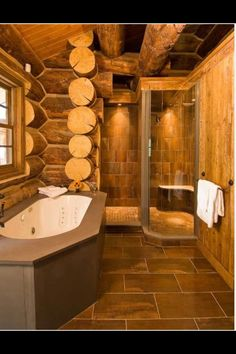 a modern rustic log home bathroom love the shower tub doesnt look natural