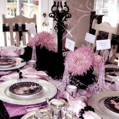 paris themed party | Setup the table with lots of pink and black! Feather boas and flowers ...
