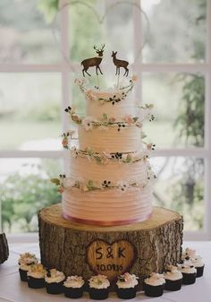 This tiered buttercream wedding cake has the SWEETEST stag and deer cake toppers! With flowers and berry garlands around each tier, we love it! 12 Amazing Autumn Wedding Cakes You'll Want Right Now - check them out on Wedding Ideas today!